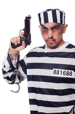 bruised: Badly bruised prisoner with gun Stock Photo