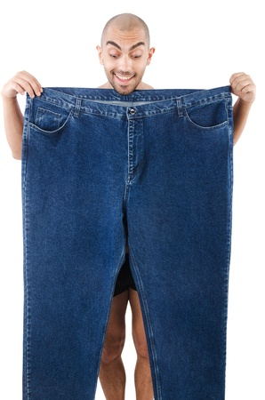 Man in dieting concept with oversized jeans Stock Photo - 22071754