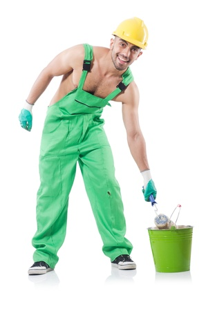 Painter in green coveralls on white Stock Photo - 22072072