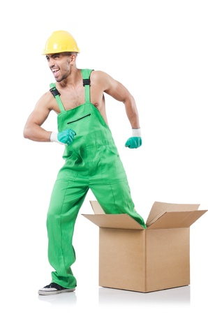 Man in coveralls with boxes photo