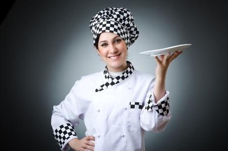 female chef: Pretty cook with kitchen utensils Stock Photo
