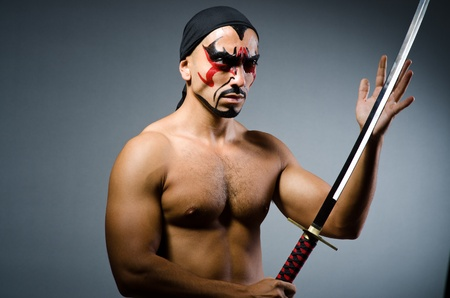 Man with sword and face paint Stock Photo - 22128360