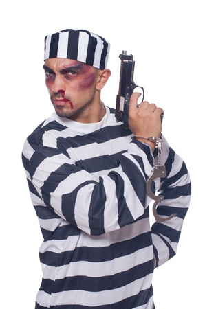 Badly bruised prisoner with gun Stock Photo - 22128312