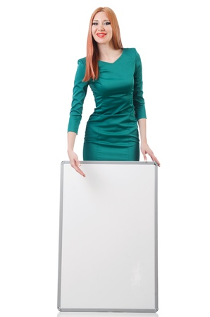 Woman in green dress with blank board photo