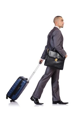 Businessman with luggage on white photo