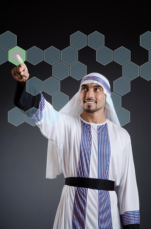 Arab businessman pressing virtual buttons Stock Photo - 22277546