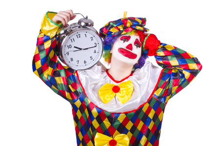 Clown with alarm clock isolated on white photo