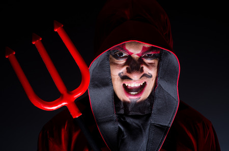 Man in devil costume in halloween concept Stock Photo - 22277956
