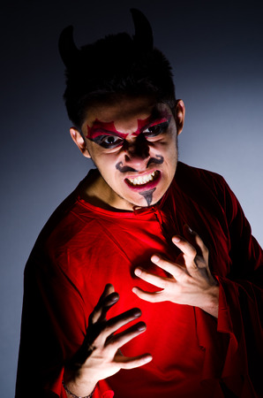 Man in devil costume in halloween concept Stock Photo - 22277958
