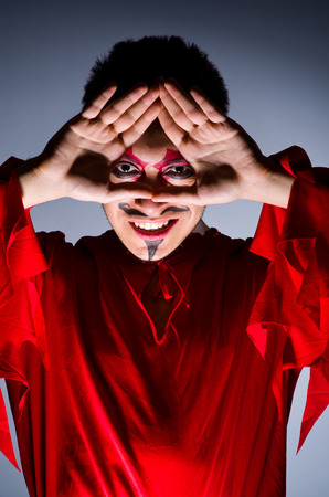 Man in devil costume in halloween concept Stock Photo - 22277959