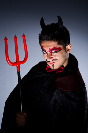 Man in devil costume in halloween concept Stock Photo - 22277960
