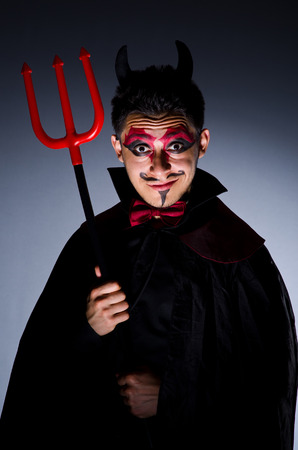 Man in devil costume in halloween concept Stock Photo - 22277961