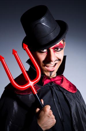 Man in devil costume in halloween concept Stock Photo - 22277965