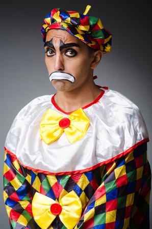 Sad clown against dark background Stock Photo - 22277979
