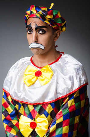 Sad clown against dark background Stock Photo - 22277979
