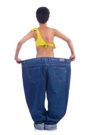 Woman in dieting concept with big jeans Stock Photo - 22277986