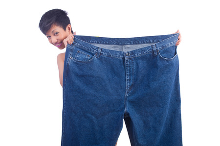 Woman in dieting concept with big jeans Stock Photo - 22277990