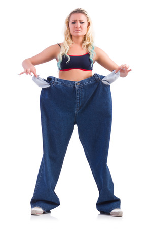 Woman in dieting concept with big jeans Stock Photo - 22278004