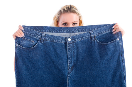 Woman in dieting concept with big jeans Stock Photo - 22278014