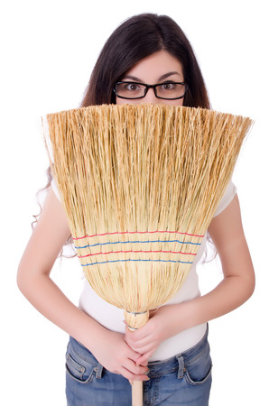 Young woman with broom on white Stock Photo - 22273370