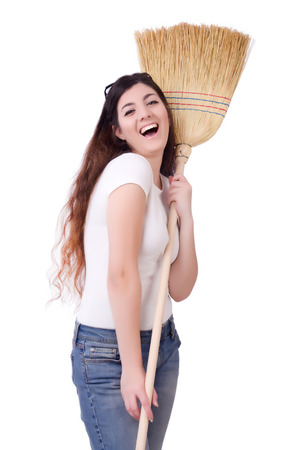 Young woman with broom on white Stock Photo - 22273422