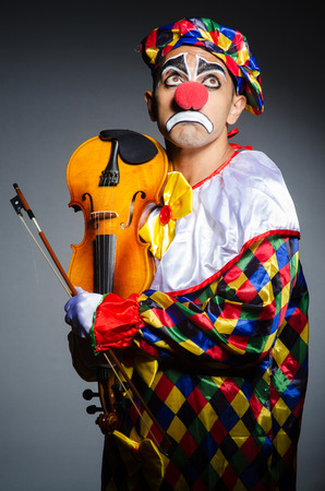 Sad clown performing at vioin Stock Photo - 22278076