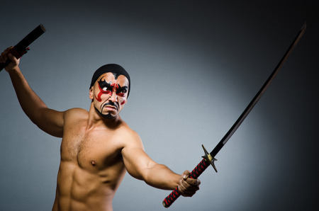 Man with sword and face paint Stock Photo - 22273768