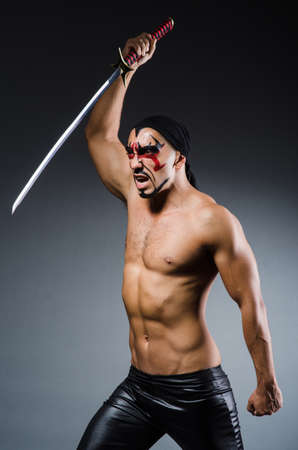 Man with sword and face paint photo