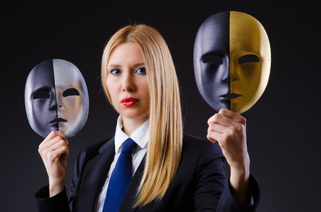 impostor: Woman with mask in hypocrisy concept