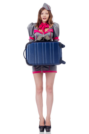 Woman travel attendant with suitcase on white photo