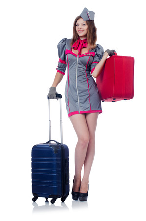 Woman travel attendant with suitcase on white Stock Photo - 22311475