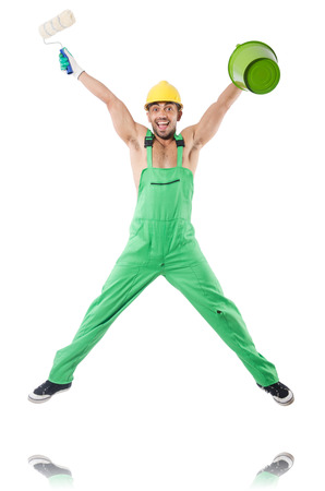 Painter in green coveralls on white Stock Photo - 22278190