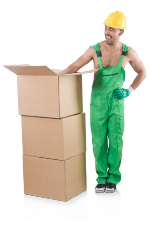 coveralls: Man in green coveralls with boxes