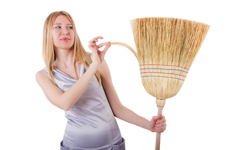 Young woman with broom on white Stock Photo - 22278227