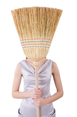 Young woman with broom on white Stock Photo - 22215177