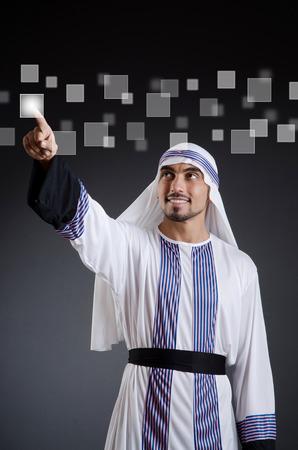 Arab businessman pressing virtual buttons photo
