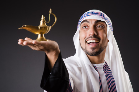 thoub: Arab with lamp isolated on the white Stock Photo