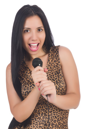 Woman singer with microphone on white photo