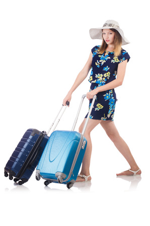 Woman with suitcases isolated on white Stock Photo - 22332122