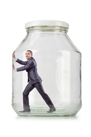 suffocating: Young businessman in glass jar Stock Photo