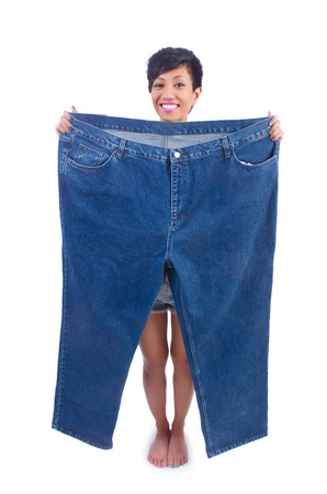 Woman in dieting concept with big jeans photo