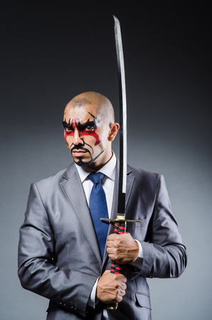 Man with face paint and sword photo
