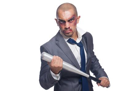 bruised: Badly bruised businessman with bat on white