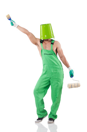 Painter in green coveralls on white Stock Photo - 22326347