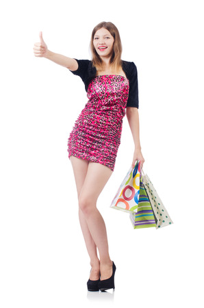 Young girl after good shopping on white photo