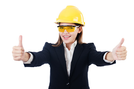 Young businesswoman with hard hat on white photo