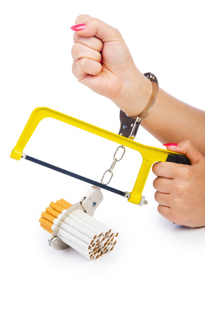 Addiction concept with cigarettes and handcuffs photo