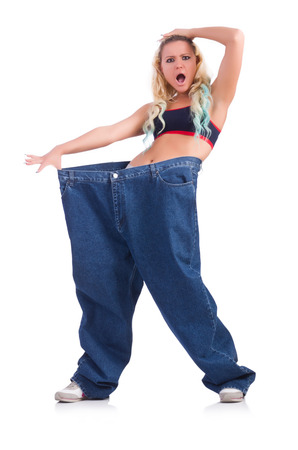 Woman in dieting concept with big jeans Stock Photo - 22476026