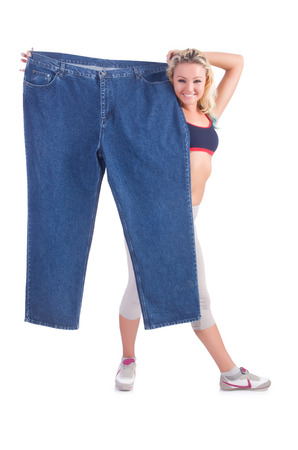 Woman in dieting concept with big jeans Stock Photo - 22476027