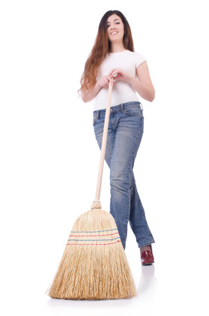 Young woman with broom on white Stock Photo - 22476030